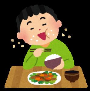 食事する男性